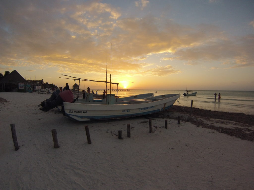 Sunset on Isla Holbox Mexico Solo Female Traveler Emily Strickland
