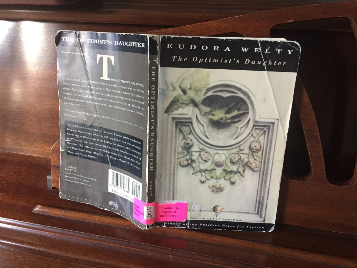 Book on a piano stand Optimist's Daughter Eudora Welty