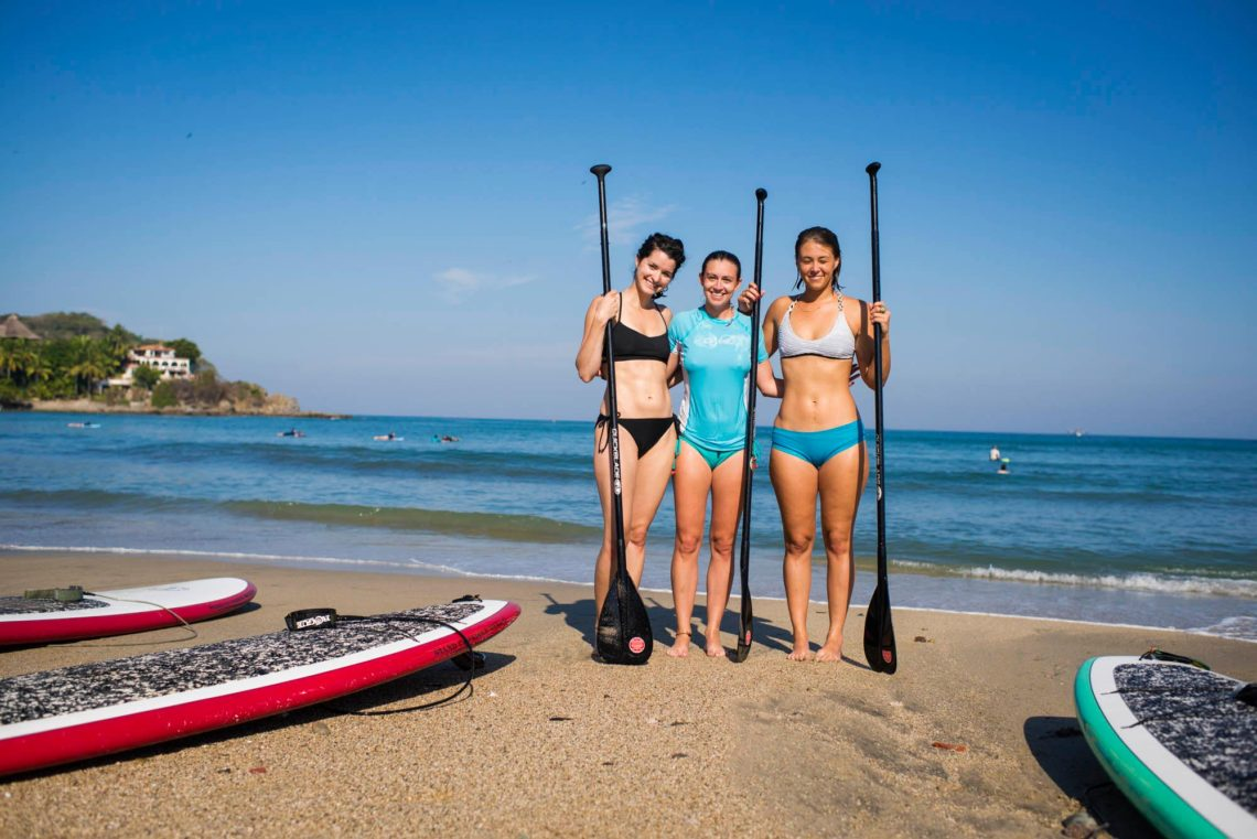 Solo female traveler Emily Strickland SUP yoga instructor Sayulita Mexico